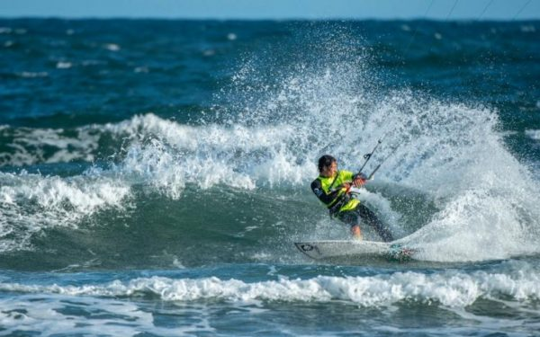 Athlete kiteboarding on a wave in Kiteboarding Australia Wave Nationals in Torquay